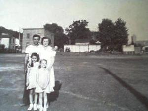 Daddy, Mother, Lillian and Shirley  - pictured in the big area in front of our house where the Ragman used to park