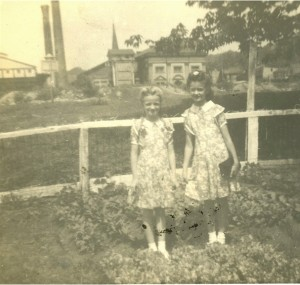 Shirley and Lillian in the Victory Garden (Water Works in the background)