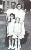Daddy, Mother, Lillian, Shirley in front of 247 Gotham Place