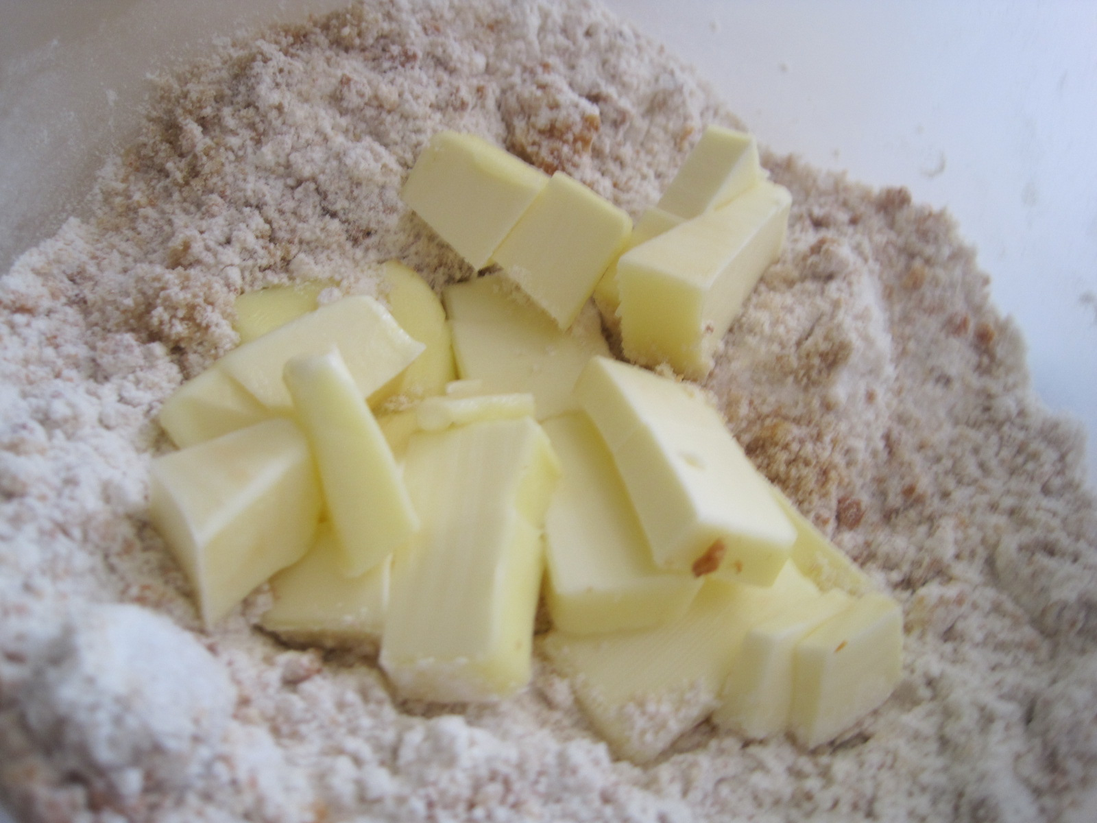 , mix together the flour, brown sugar, granulated sugar, and amaretti ...