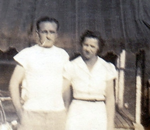 My father and mother standing in front of the back porch where my father had his workshop