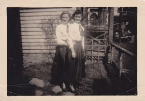 """My sister, Shirley, and I are standing in our front yard in 1949.  I was a junior at Withrow High School and Shirley was in the 8th grade at Highlands (Cincinnati).  Mother made our """"Dottie Mack""""* dresses"""