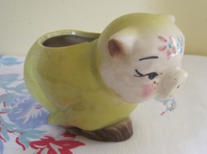 And for no particular reason other than it matched my newly-painted kitchen, a chubby yellow pig planter.